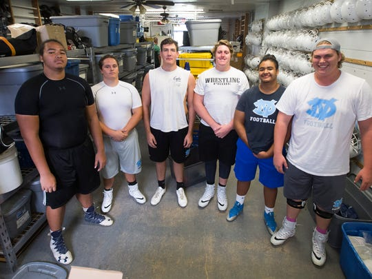 Deer Valley's offensive line Xavier Robinson-Delgado (L-R), Bryce Taylor-Wyers, Gunnar Johnson, Brandon McCrea, Noah Cervantes and Joey Ramos at Deer Valley High School in Glendale, Ariz. on August 3, 2017.