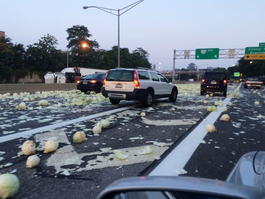 A truck carrying cabbage rolled over on 490 West, spilling its load across the Interstate near the Clinton Avenue exit.
