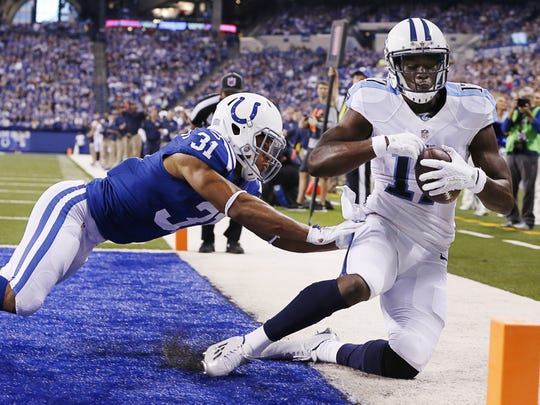 Tennessee Titans wide receiver Dorial Green-Beckham (17) pulls in a high pass for the touchdown over Indianapolis Colts cornerback Jalil Brown (31) at Lucas Oil Stadium on Jan. 3, 2016.