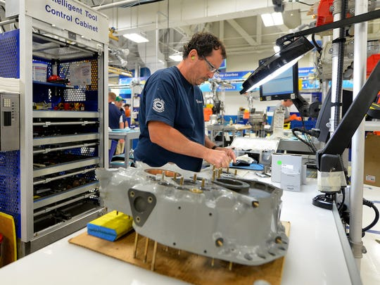 A Rolls-Royce employee worked on a gear box assembly in September 2015 at the company's facility at Tibbs Avenue and Raymond Street.