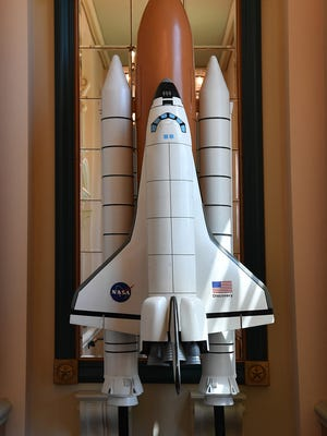 A NASA Space Shuttle model stands about 12-feet tall at the entrance to the Northlight Gallery at the Kemp Center for the Arts for the Youth ArtZeum Outer Space exhibit.