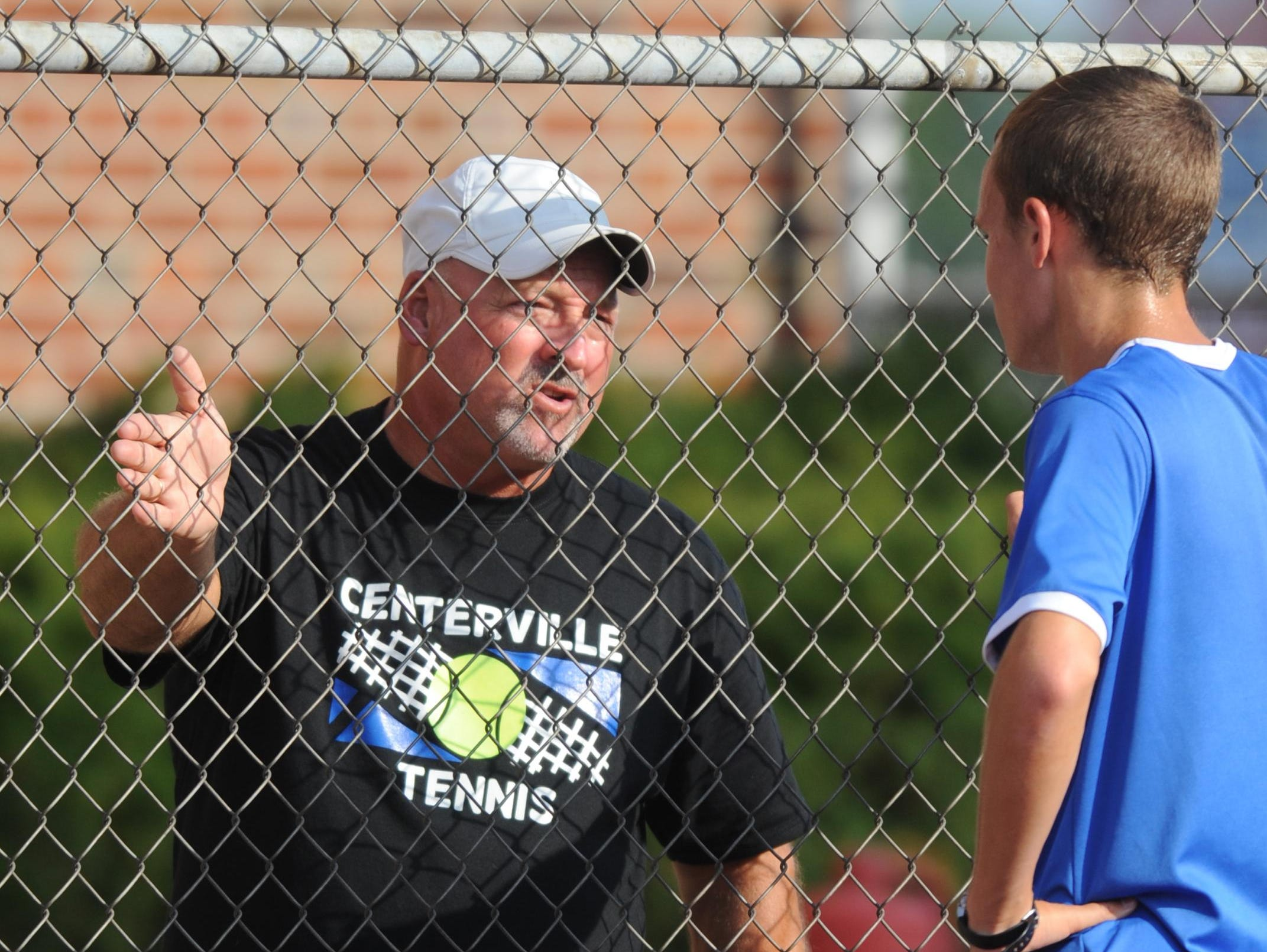 Randy Ecker has coached Centerville's boys tennis program for 35 years. He'll coach against daughter Courtney, in her first year leading Hagerstown, on Thursday.
