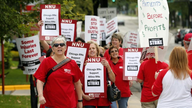 Allina Health nurses protest outside Abbott Northwestern Hospital in Minneapolis on Monday, Sept. 5, 2016, as they began an open-ended strike after a failure to reach a settlement with Allina Health.