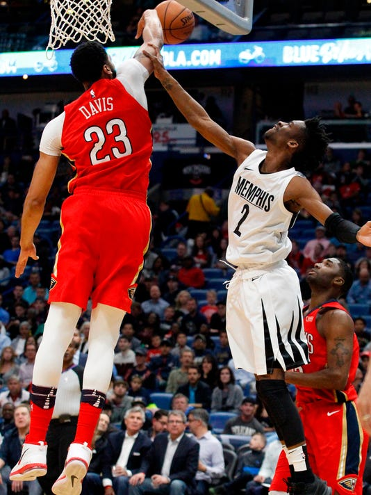 New Orleans Pelicans forward Anthony Davis (23) blocks a shot by Memphis Grizzlies guard Kobi Simmons (2) during the first half of an NBA basketball game in New Orleans, Wednesday, April 4, 2018. (AP Photo/Scott Threlkeld)