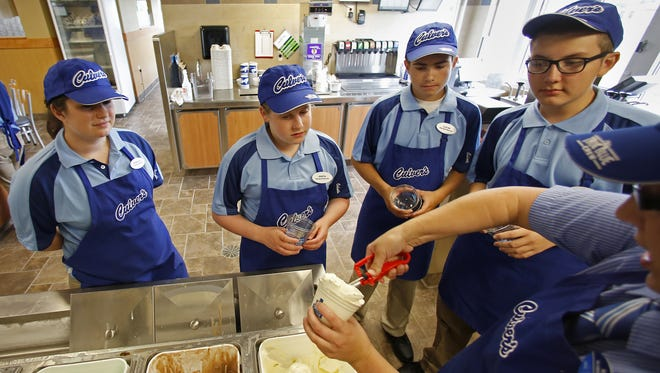 From left: Rebecca Bongers,19, Greta Litche, 14, Lucas Montag, 14, and Elijah Sanchez, 15, listen as Amanda Mihalic show how to serve a custard dessert during a Culver's employee training session on Tuesday, August 19, 2014, in Little Chute, Wis. The Little Chute franchise will open Monday, August 25.      Joshua Bessex/Post-Crescent Media