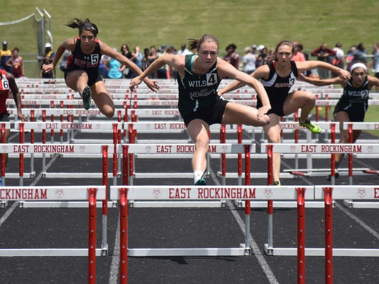 Wilson Memorial's Emilie Miller, center, leads her preliminary heat of the girls 100-meter hurdles at the VHSL Region 2A East track championships on Friday, May 26, 2017, at East Rockingham High School in Elkton, Va.