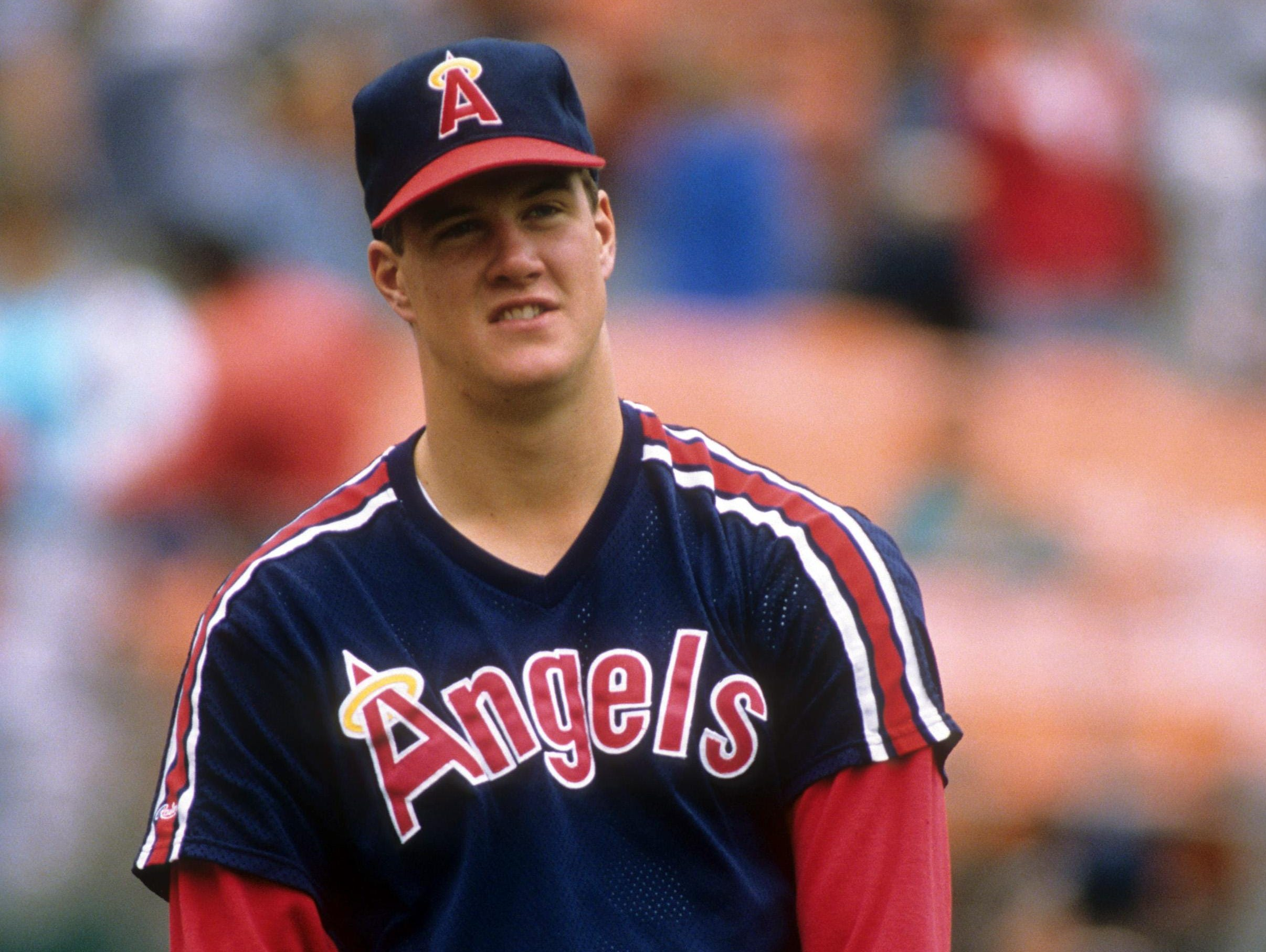 Pitcher Jim Abbott of the California Angels warms-up before an MLB game against the Oakland Athletics circa 1989 at the Oakland Coliseum.