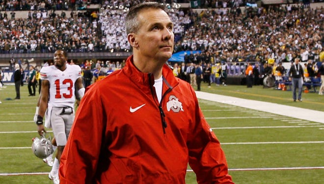 Ohio State coach Urban Meyer walks off the field after the Buckeyes fell to Michigan  State in the Big Ten title game.