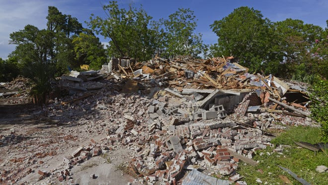 What is left of the John Sunday house after demolition started Saturday.