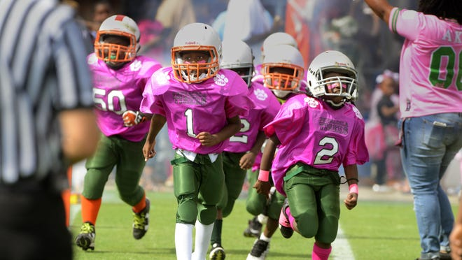 The Pensacola Tigers take the field Saturday during the Soul Bowl at Blue Wahoos Stadium.