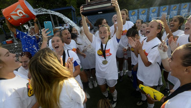 The West Florida soccer team celebrates after winning the 2016 Gulf South Conference Women's Soccer Championship by beating Mississippi College 2-0 Sunday at the UWF Soccer Complex.