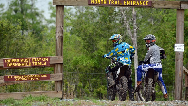 Riders get ready to hit the trail Saturday at the Clear Creek OHV (Off Highway Vehicle) trails in Milton.