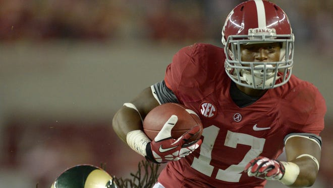 Running back Kenyan Drake (17) and Alabama are the No. 1 team in the nation, but would the Crimson Tide win the College Football Playoff if it were to happen today?