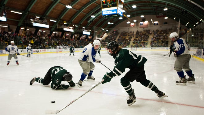 Stowe's Chad Haggerty (15) skates with the puck during the Division II high school boys hockey championship between Stowe and U-32 at Gutterson Fieldhouse on Monday night.