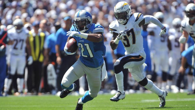 Detroit Lions running back Ameer Abdullah (21) rushes for a touchdown ahead of San Diego Chargers defensive back Jahleel Addae (37) during the first quarter of the game at Qualcomm Stadium.