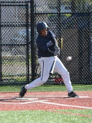 Poughkeepsie's Jesus Fabian Peralta makes a hit during Monday's game against Red Hook.