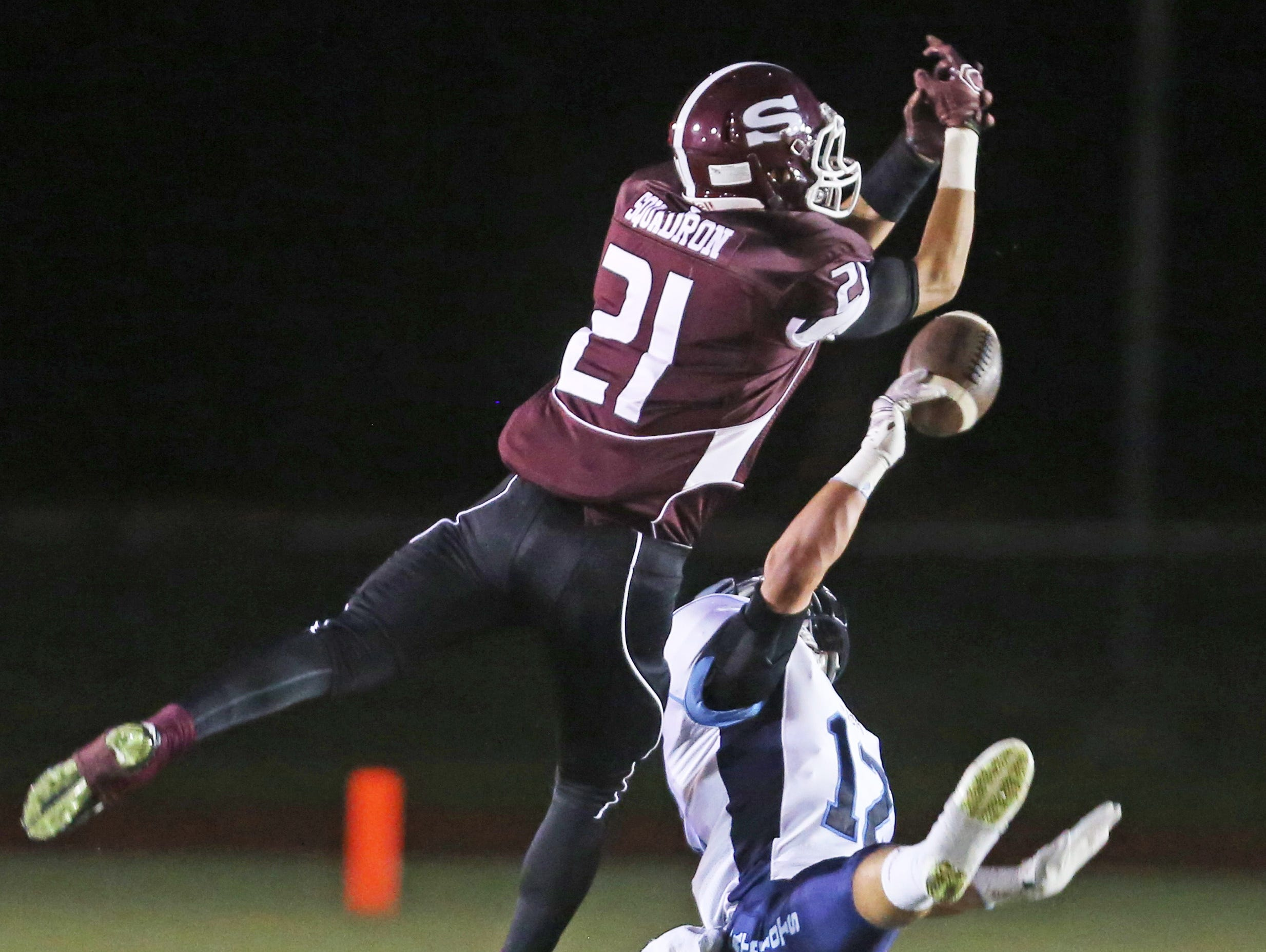 Jason Eisner of John Jay East Fishkill breaks up a pass intended for Scarsdale's Sam Squadron during a varsity football game at Scarsdale High School Sept. 25, 2015.