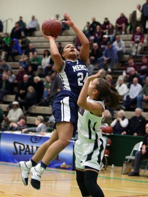 Mercy's Traiva Breedlove (24) drives to the basket against Ossining-I during the girls Class AA state semifinal  game at Hudson Valley Community College in Troy March 17, 2017.