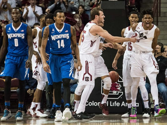 South Carolina forward Chris Silva, right, celebrates with teammates during the first half of an NCAA college basketball game against Memphis, Saturday, Jan. 2, 2016, in Columbia, S.C. (AP Photo/Sean Rayford)