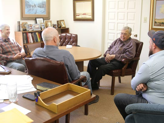 Left to right, John Alexander, Kurt Fagrelius, Tom Dugan and Sean Dugan talk about Dugan Production Corp. at the company's offices in Farmington earlier this month.