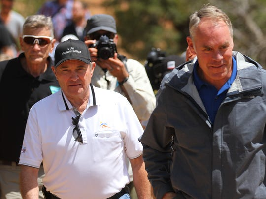 Utah Governor Gary Herbert, left, and U.S. Interior Secretary Ryan Zinke make their way to their press conference, Monday, May 8, 2017 at Butler Wash southwest of Blanding, Utah.