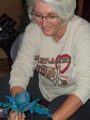 "Linda Wallander helps prep Vilas Rahr Mansion at Rahr-West Art Museum in Manitowoc for ""Christmas in the Mansion,"" which runs Nov. 23-Jan. 8."