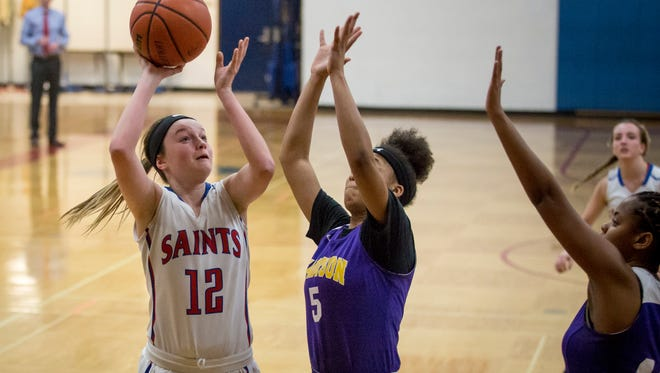 St. Clair's Mia Janssen takes a shot over Madison Heights' Alexus Pack during a basketball game Tuesday, Feb. 14, 2017 at St. Clair High School.