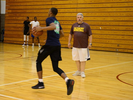 At a 2017 Nike Boys Basketball Camp at Salisbury University led by then-head men's coach Andy Sachs and staff, Sachs works with young players with high-energy skills, shooting drills, and scrimmages. (STAFF FILE PHOTO)