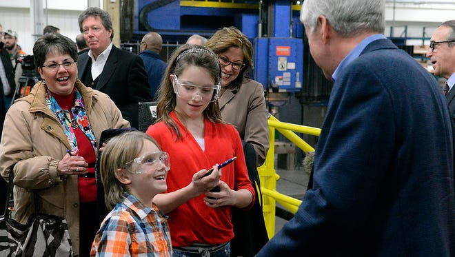 Reid Rusthoven, 8, and his sister Elsa, 11, talk with Michigan Gov. Rick Snyder after he spoke at Franchino Mold and Engineering, ib Jan. 21 in Lansing, where the governor was promoting apprenticeships in the skilled trades. Michigan's unemployment rate rate dropped to 5.6% in March.