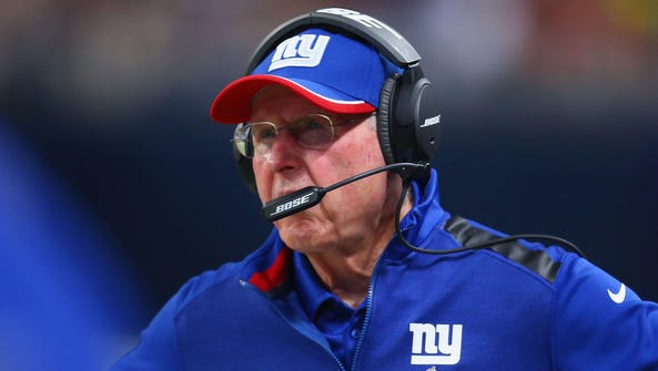 Tom Coughlin, pictured, Ernie Accorsi and Justin Tuck