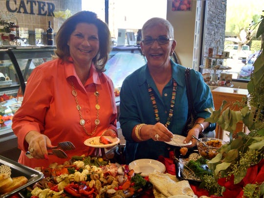Andrea Rosenblatte and Dawn Rashid sample party platters during the Cello's Pantry open house.