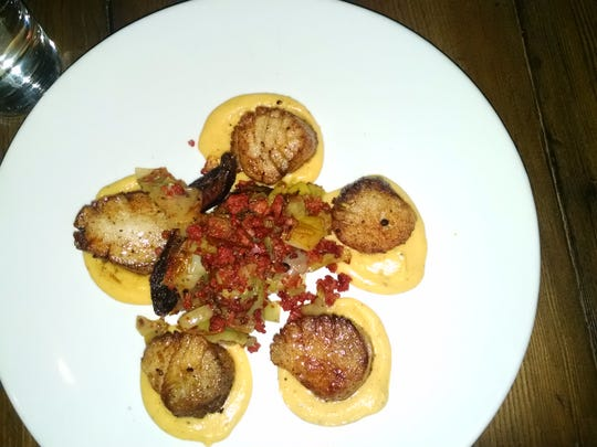 Catalan's dishes include this pan-seared scallops with butternut squash and chorizo.