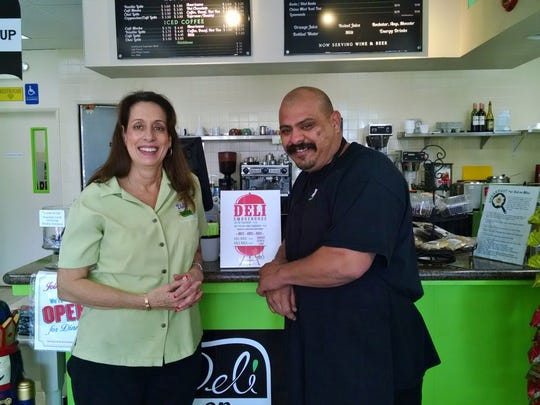 Deli on Miles owner Elaine Holmes poses with the chef, Mariano Flores.