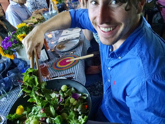 A guest helps himself to the roasted fig summer salad at Sparrows Lodge in Palm Springs.