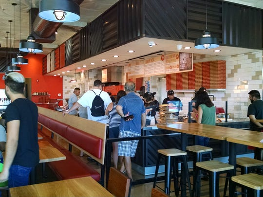 Blaze Pizza customers place their orders.