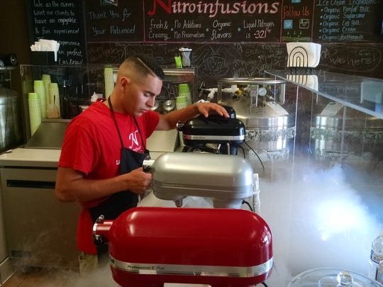 Cold steam billows as a server at Nitro Infusions in La Quinta makes banana-lavender ice cream.