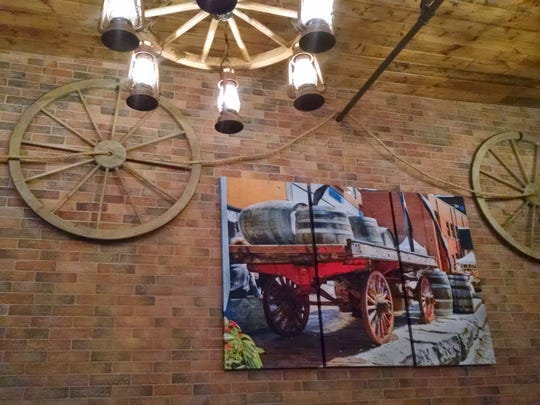 The brick wall and wagon wheel decor add a rustic warmth and charm to Alps Village.
