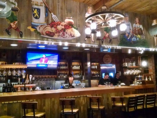 German decorating touches above the bar and flat-screen