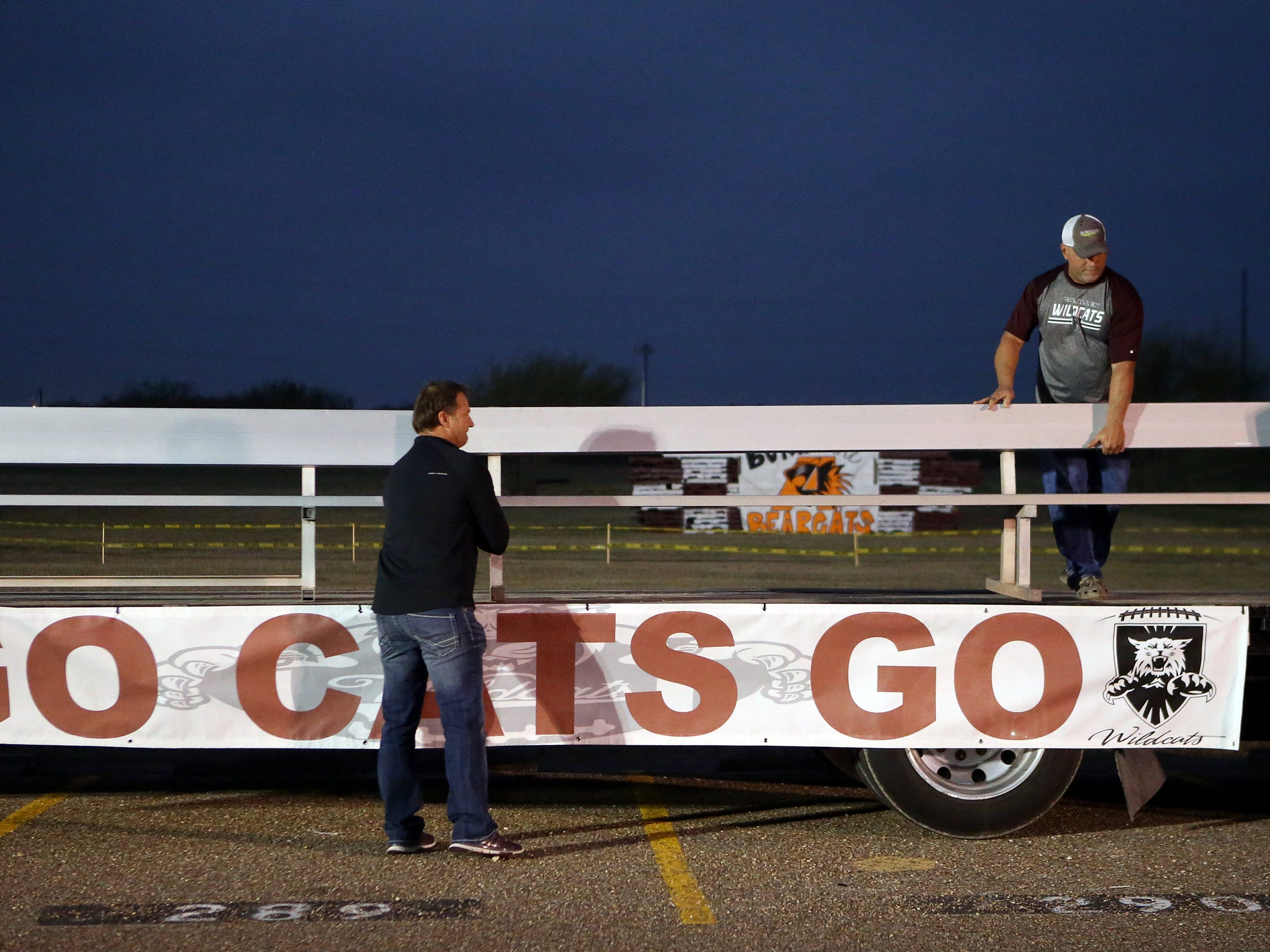 Calallen Booster Cub members Lawrence Mann (left) and Marcus Darbonne adjust bleachers as they prepare for a community pep rally Dec. 14, 2016, at Calallen High School in Corpus Christi. Calallen will be playing Aledo High School for the Class 5A Division II State Championship on Friday.