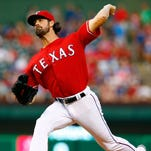 Cole Hamels of the Texas Rangers pitches against the