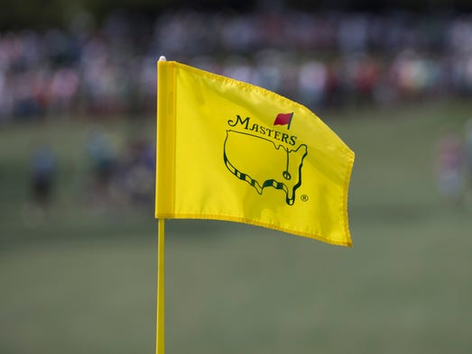 The flagstick on the seventh green flutters as patrons