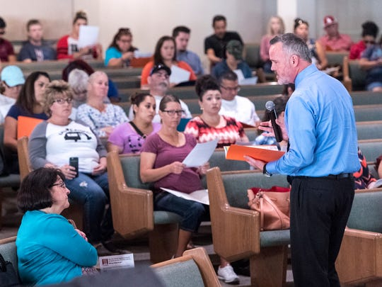 Jonathan Thompson from the Employment Connection speaks Monday, October 30, 2017 at Tulare First Baptist Church to about 80 of the 500-plus employees from Tulare Regional Medical Center facing unemployment. Additional sessions for information are available.