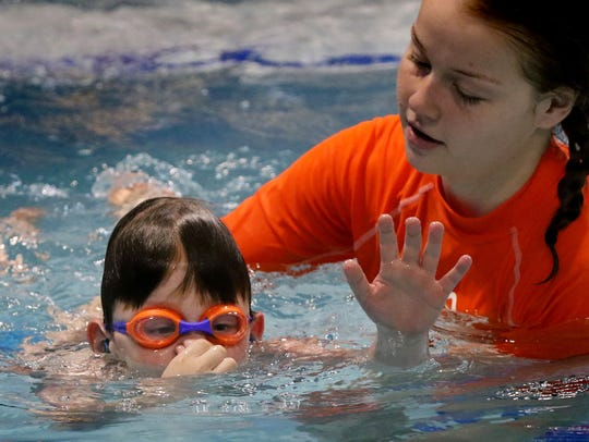 Carter Sobush works with Rachel Koch in an individual lesson at Goldfish Swim School in Brookfield on April 12. Carter began swim lessons in December and within a month was comfortable enough to put his face in the water.
