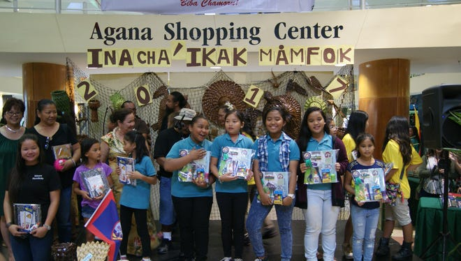 The GDOE Chamoru Studies Division held a Mamfok Competition(Weaving) on March 19, at Agana Shopping Center, one of several Island-wide Chamoru Month 2017 Activities. Category 3: 1st Place Winner Wettengel Elementary School. Pictured from left: Minalynn Manibusan, Kaelyn Santos, Jovina Nachuo, Daija-Nyah Santos, Ysabelle Bugarin, Minami Balbin, and Sylvia Thol. Pictured in back from left:  Evangeline Iglesias(Wettengel Elementary School, Principal), Sinora Jowinalyn Mendiola, Sinora Dorebbie Lujan(Wettengel Elemenatary School, CHamoru Language Teacher), Sinot Francisco Manglona(Astumbo Elemenatary School, CHamoru Language Teacher), Art Pangelinan(Judge), James Bamba(Judge), Sinot Joseph Babauta(Marcial Sablan Elemenatary School, CHamoru Language Teacher and Mamfok Competition Committee Chair), Sinora Lorenza Muna(Tamuning/LBJ Elemenatary School, CHamoru Language Teacher), Sinora Valerie Cruz(Tamuning/LBJ Elemenatary School, CHamoru Language Teacher), Sinora Rufina Mendiola(CHamoru Studies and Special Projects Division, Administrator), and Sinora Dolores Aguon(John F. Kennedy High School, CHamoru Language Teacher).