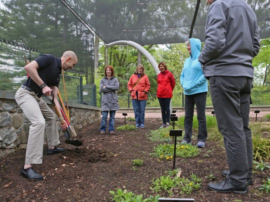 Physical therapist Aron McConnell teaches a class of gardening enthusiasts the principles of ergonomics to prevent injuries while gardening at Mt. Cuba Center
