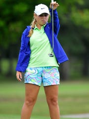 Rossview's Caroline Caudill lines up a putt on the