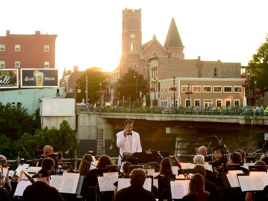 The Binghamton Philharmonic performs Pops on the River on Thursday, July 19, 2018, at the Chenango Riverwalk Promenade in Binghamton. The free event marks a revival of the Pops on the River, which had been longstanding tradition from 1980 until 1994.