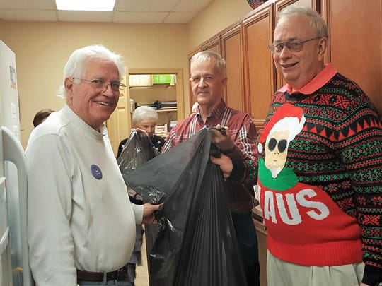 Holiday Cleanup - The Evansville Duplicate Bridge Club's men were seen cleaning up after the Christmas Party, raising $684 for The Albion Fellows Bacon Center.  Pictured are Dr. Jef' Franklin, Kirk Ranta and Pete Lambert.