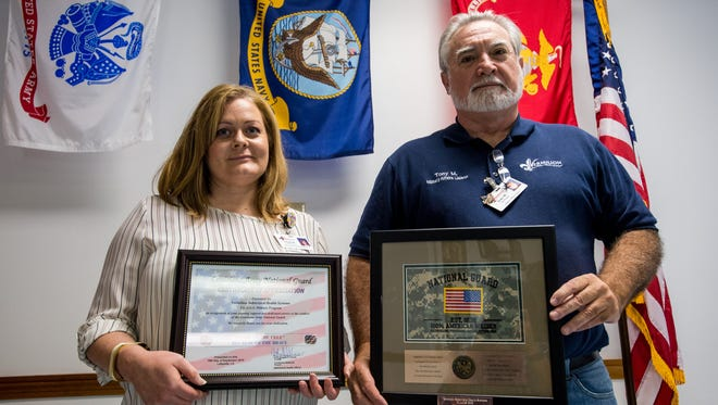 Glynis DeRoche, director of clinical services, and Tony Miller, military affairs liaison, hold two plaques given awarded to Vermilion Behavioral Health Systems in recognition for their FLAGS program in Lafayette, La., Friday, Oct. 2, 2015. The FLAGS program, which stands for Forgiving Losses and Gaining Strength, is designed to assist military veterans with a variety of mental health issues at the facility.