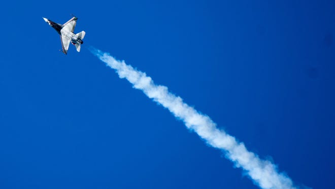 A model jet shows what it can do across the desert sky.